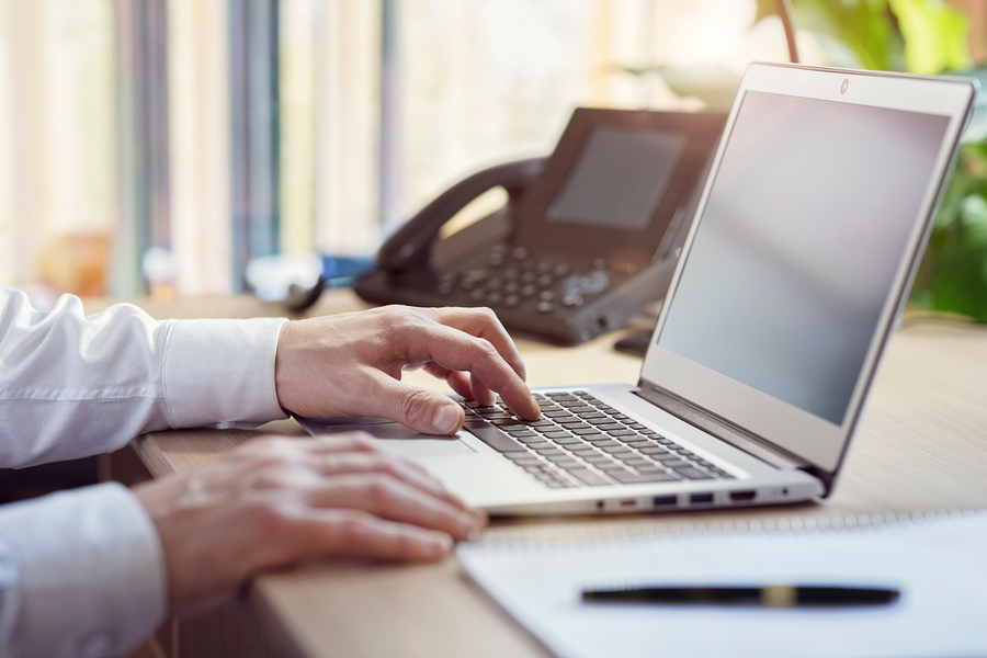 Businessman using laptop computer in office